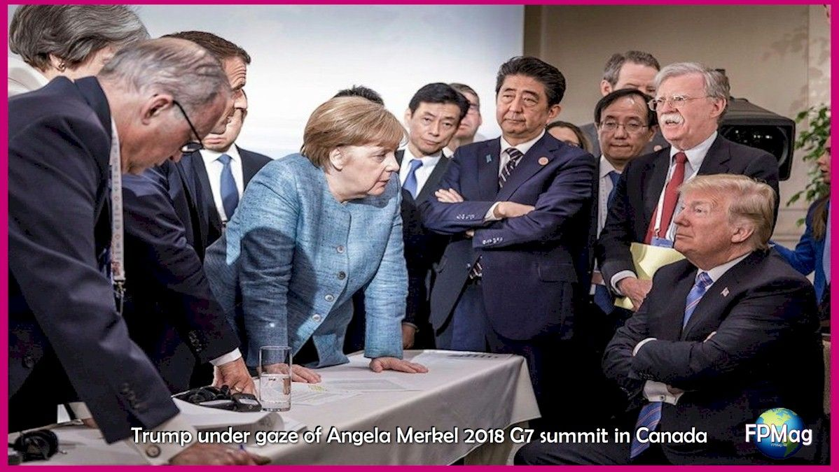 Trump under gaze of Angela Merkel -- Day two of the G7 summit in Canada: spontaneous meeting between two working sessions. # G7Charlevoix # g7 # with #multilateralism #multilateralism