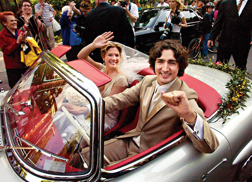 Justin and his wife in Pierre's Car on their wedding day