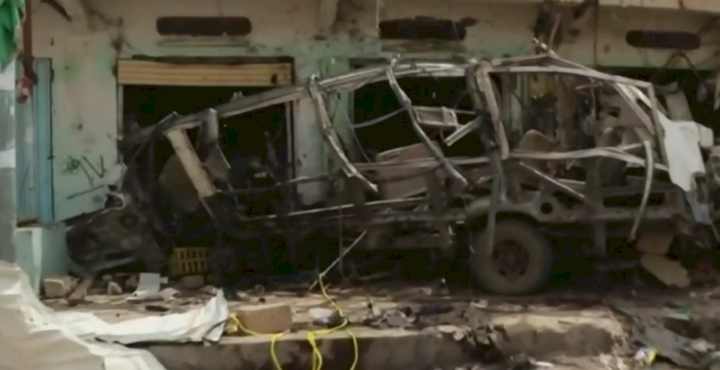 All that remains of school bus after being hit by American 500 pound bomb.