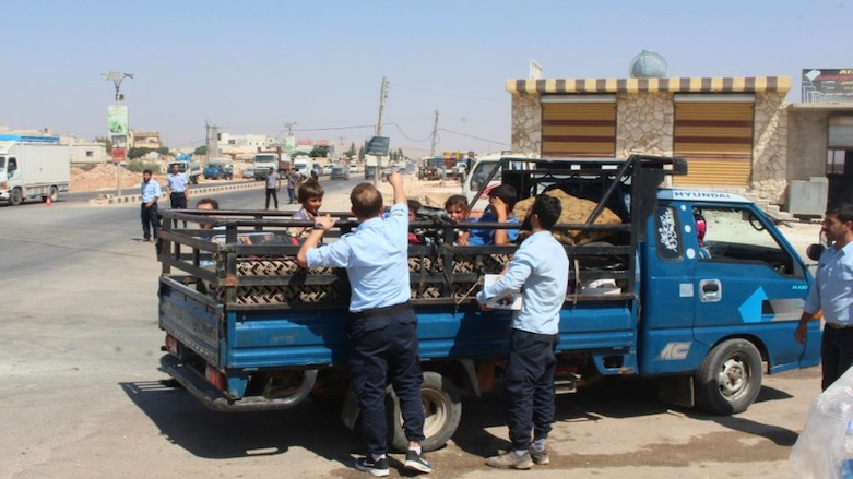 Idlib Police share water with the community on a very hot Wednesday afternoon.