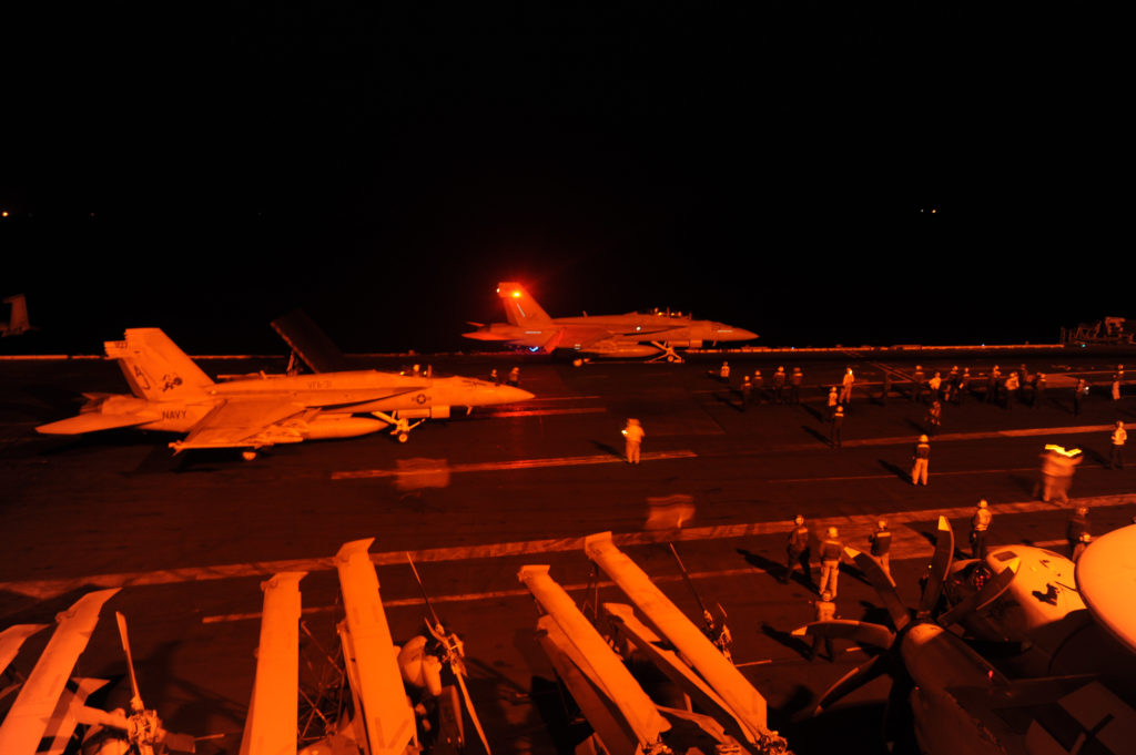 140923-N-MT637-040 ARABIAN GULF (Sept. 23, 2014) An F/A-18E Super Hornet, attached to Strike Fighter Squadron (VFA) 31, and an F/A-18F Super Hornet, attached to Strike Fighter Squadron (VFA) 213, prepare to launch from the flight deck of the aircraft carrier USS George H.W. Bush (CVN 77) to conduct strike missions against ISIL targets. George H.W. Bush is supporting maritime security operations and theater security cooperation efforts in the U.S. 5th Fleet area of responsibility. (U.S. Navy photo by Mass Communication Specialist 3rd Class Robert Burck/Releasedl)