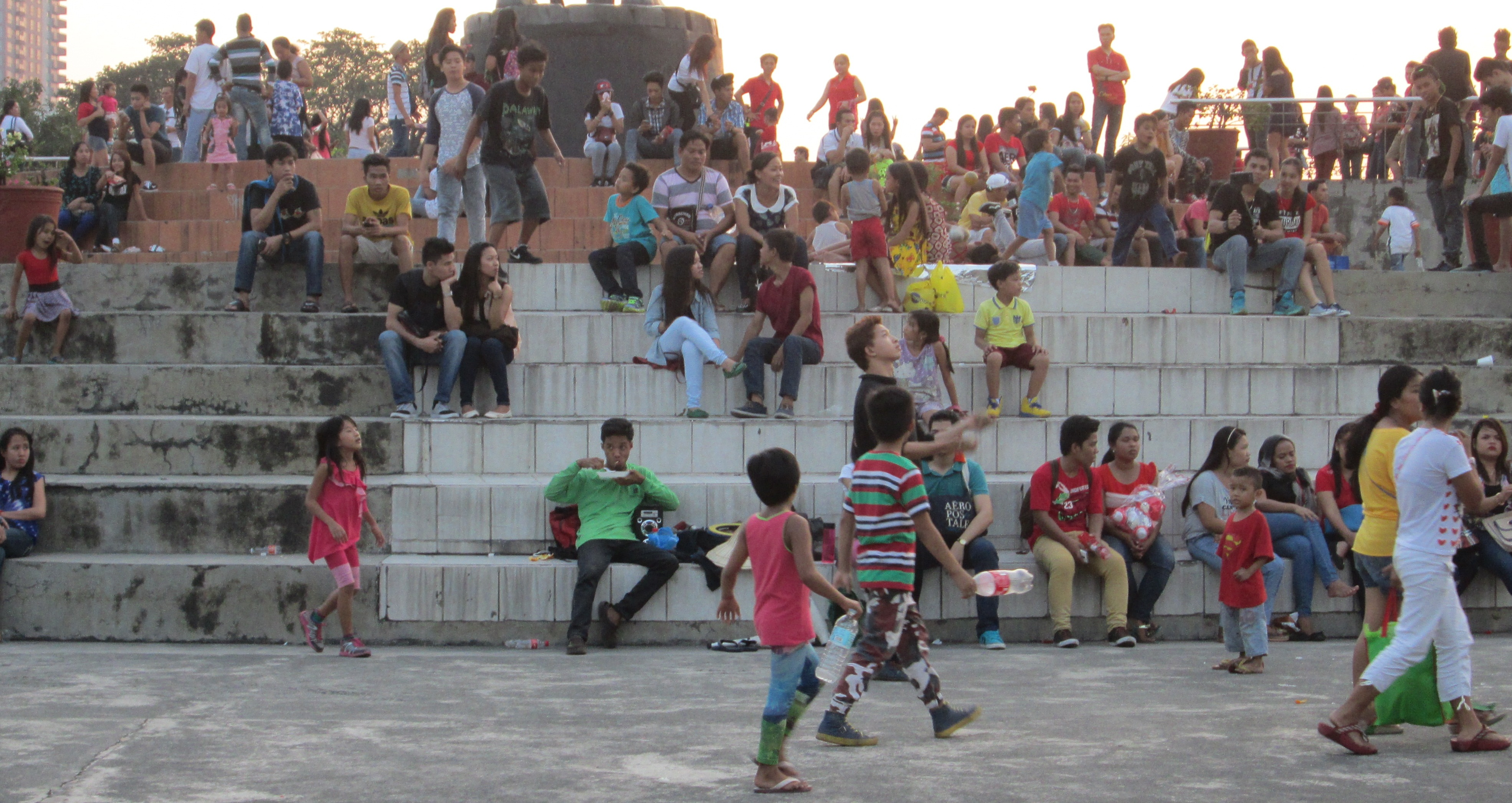 (Rizal) Luneta Park in the Philippines. CHildren and some families playing