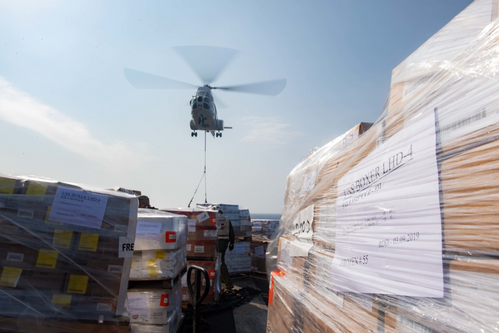 RED SEA (Sept. 12, 2019) A Military Sealift Command SA-330J Puma helicopter sets a pallet on the flight deck of amphibious assault ship USS Boxer (LHD 4) during a vertical replenishment-at-sea. Boxer is part of the Boxer Amphibious Ready Group and 11th Marine Expeditionary Unit and is deployed to the U.S. 5th Fleet area of operations in support of naval operations to ensure maritime stability and security in the Central Region, connecting the Mediterranean and the Pacific through the Western Indian Ocean and three strategic choke points. (U.S. Navy photo by Mass Communication Specialist 2nd Class Dale M. Hopkins/Released)